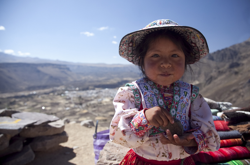 Peruvian girl with rock
