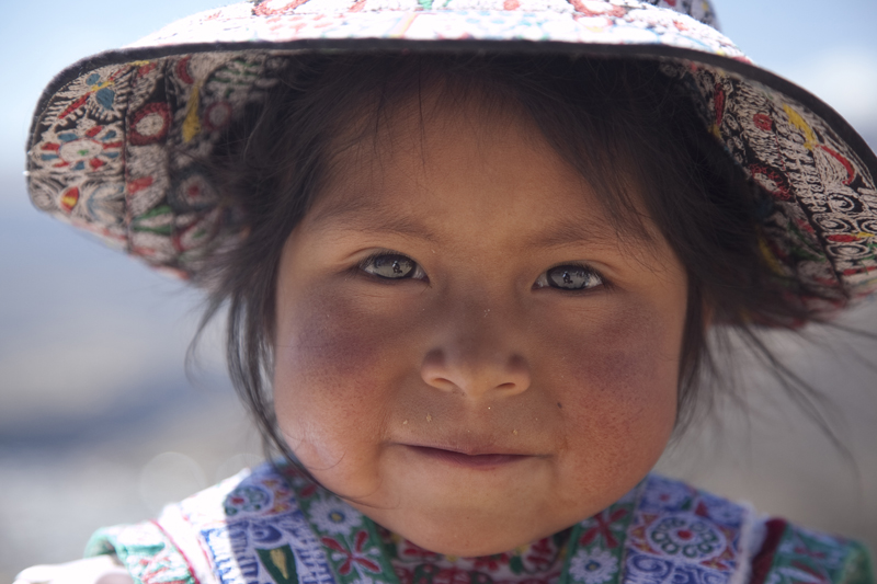 Close up Peruvian girl with rock